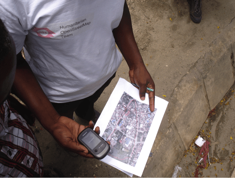 Community members with Humanitarian OpenStreetMap, a partner with Ramani Huria, leverage imagery to begin mapping and capturing GPS coordinates.