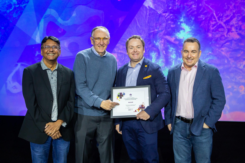 Maxar accepting 2020 Cornerstone Partner award from Esri